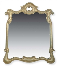 A SILVERED-WOOD MIRROR,