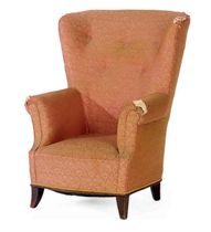 A GERMAN MAHOGANY AND UPHOLSTERED WINGBACK ARMCHAIR,