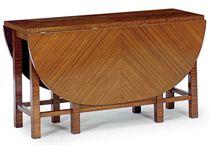 A GERMAN MAHOGANY DROP-LEAF DINING TABLE,