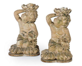 A PAIR OF TINTED PLASTER FIGUR