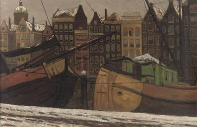 Damrak Amsterdam: moored boats