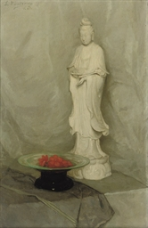 A Guanyin statue and a bowl wi