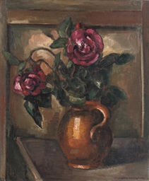 Red roses in an earthenware va