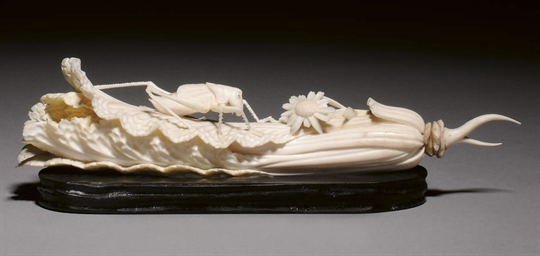 AN IVORY CARVING OF A GRASSHOP