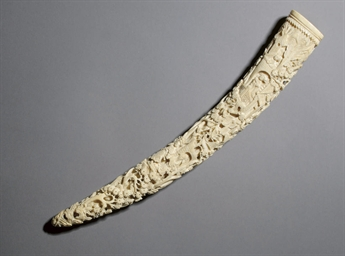 A CARVED IVORY TUSK, 19TH CENT
