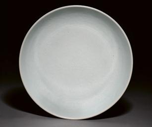 A WHITE GLAZED CIRCULAR DISH,