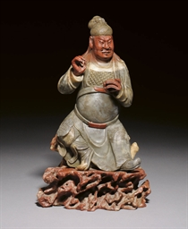 A LARGE CARVED SOAPSTONE FIGUR