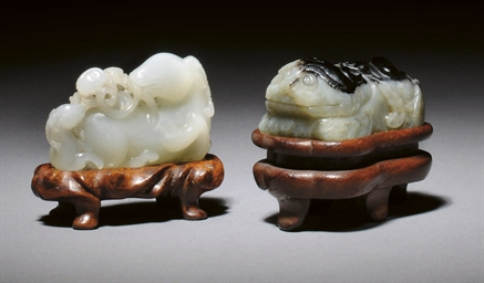 A WHITE JADE CARVING OF A RAM,
