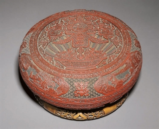 A CARVED THREE-COLOUR LACQUER