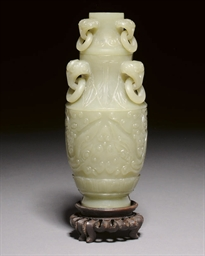 A SMALL CELADON JADE VASE AND