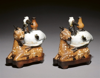 A PAIR OF GLAZED POTTERY CRANE