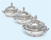 A SET OF THREE AUSTRIAN SILVER ENTREE-DISHES AND COVERS