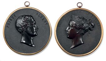A PAIR OF VICTORIAN BOIS DURCI PORTRAIT PLAQUES OF QUEEN VICTORIA AND PRINCE ALBERT