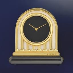 A gilt quartz desk clock, by B