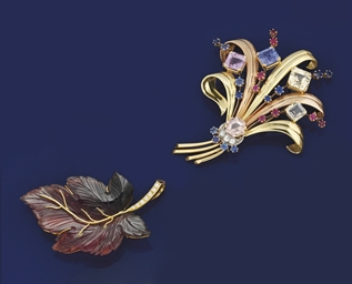 Two diamond and gem brooches