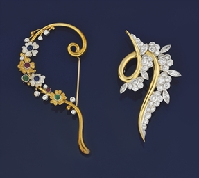 Two diamond set brooches