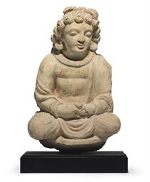 A stucco figure of a Bodhisatt