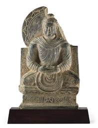 A green schist figure of Buddh