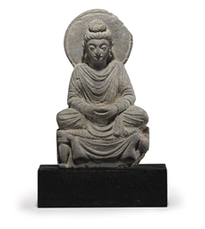 A gray schist figure of Buddha