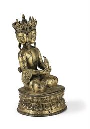 A gilt bronze figure of Vairoc