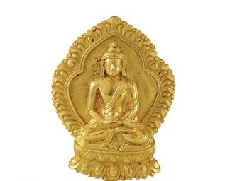 A small gold figure of Buddha