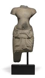 A sandstone torso of a deity
