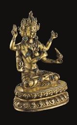 A gilt bronze Guhyasamaja reti