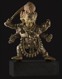A small bronze figure of Achal