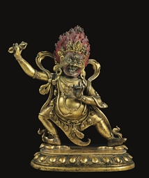 A gilt bronze figure of a Wrat