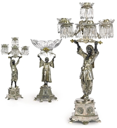 A SPANISH SILVER FIGURAL THREE