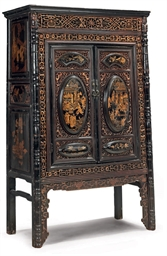 A CHINESE CARVED AND LACQUERED
