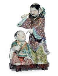 A CHINESE FAMILLE ROSE FIGURAL