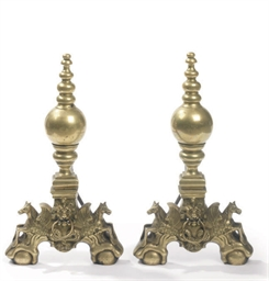 A PAIR OF DUTCH BRASS ANDIRONS