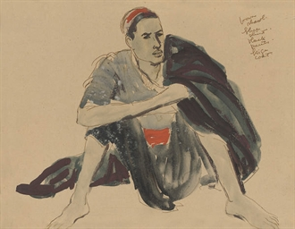 A seated young man in a red sa