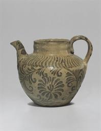 An Iron-decorated Celadon Ston
