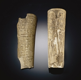 A CARVED BONE FRAGMENT
