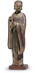 A PAINTED WOOD FIGURE OF A FEM