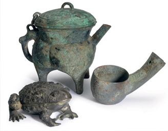A CHINESE ARCHAIC BRONZE POURING VESSEL AND COVER, HE, AND A...