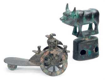 A CHINESE BRONZE WHEELED BIRD-