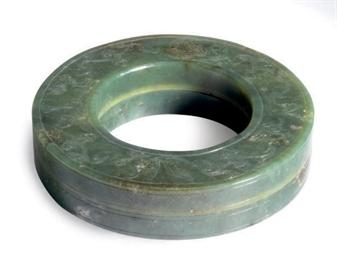 A CHINESE GREEN JADE CIRCULAR