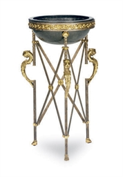A STEEL AND BRASS JARDINIERE,