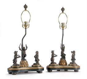 A PAIR OF PATINATED METAL FIGU