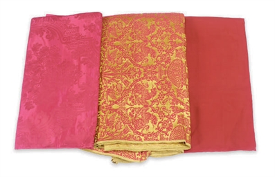 A GROUP OF RED SILK AND DAMASK
