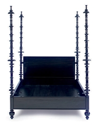 AN EBONIZED FOUR-POSTER BED,