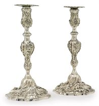 A PAIR OF GEORGE III CAST SILVER CANDLESTICKS