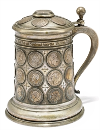 A GERMAN SILVER COIN TANKARD O