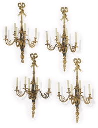 A SET OF FOUR LARGE GILT AND P