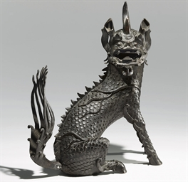 A LARGE BRONZE QILIN-FORM CENS