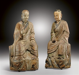 TWO PAINTED WOOD FIGURES OF SE