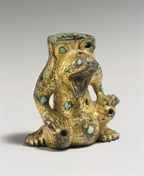 A SMALL TURQUOISE-INLAID GILT-